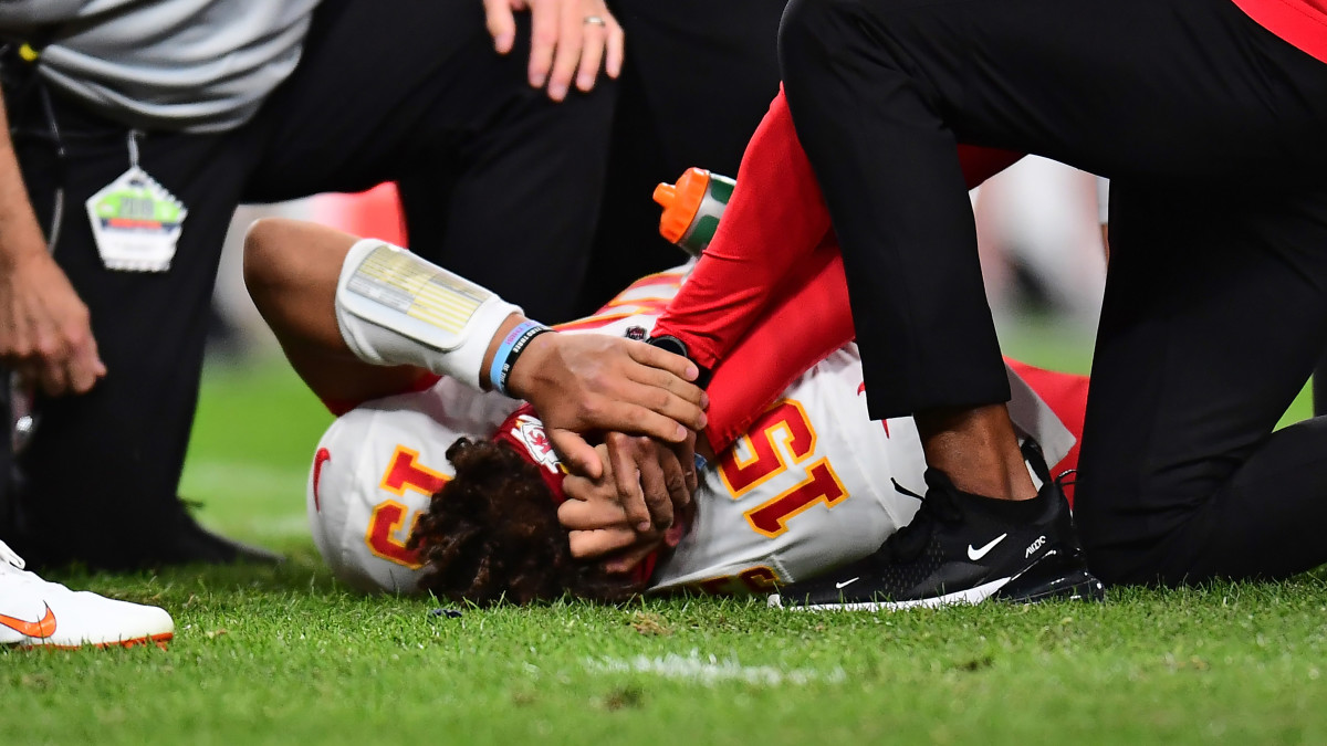 Injured Patrick Mahomes lays on the field