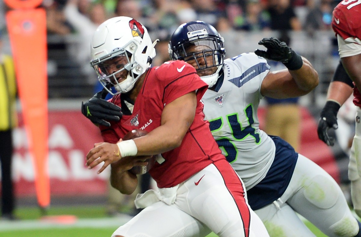 Linebacker Bobby Wagner wraps up quarterback Kyler Murray during the Seahawks Week 4 win over the Cardinals.
