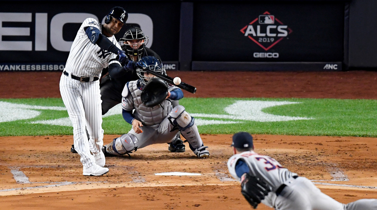 Oct 18, 2019; Bronx, NY, USA; New York Yankees center fielder Aaron Hicks (31) hits a three run home run against Houston Astros starting pitcher Justin Verlander (35) during the first inning of game five in the 2019 ALCS playoff baseball series at Yankee Stadium. Mandatory Credit: Robert Deutsch-USA TODAY Sports