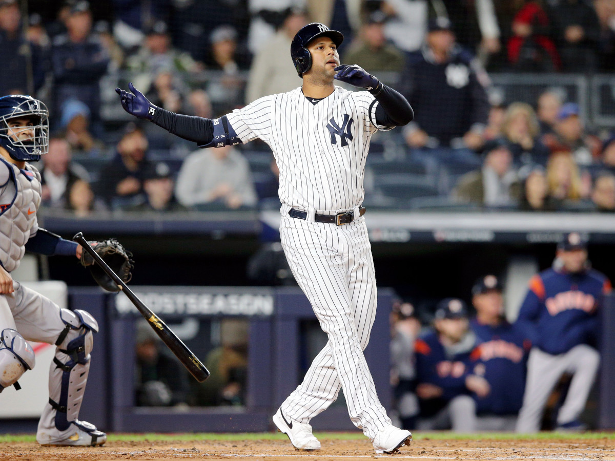 Oct 18, 2019; Bronx, NY, USA; New York Yankees center fielder Aaron Hicks (31) drops his bat as he watches his three run home run against the Houston Astros during the first inning of game five of the 2019 ALCS playoff baseball series at Yankee Stadium. Mandatory Credit: Brad Penner-USA TODAY Sports