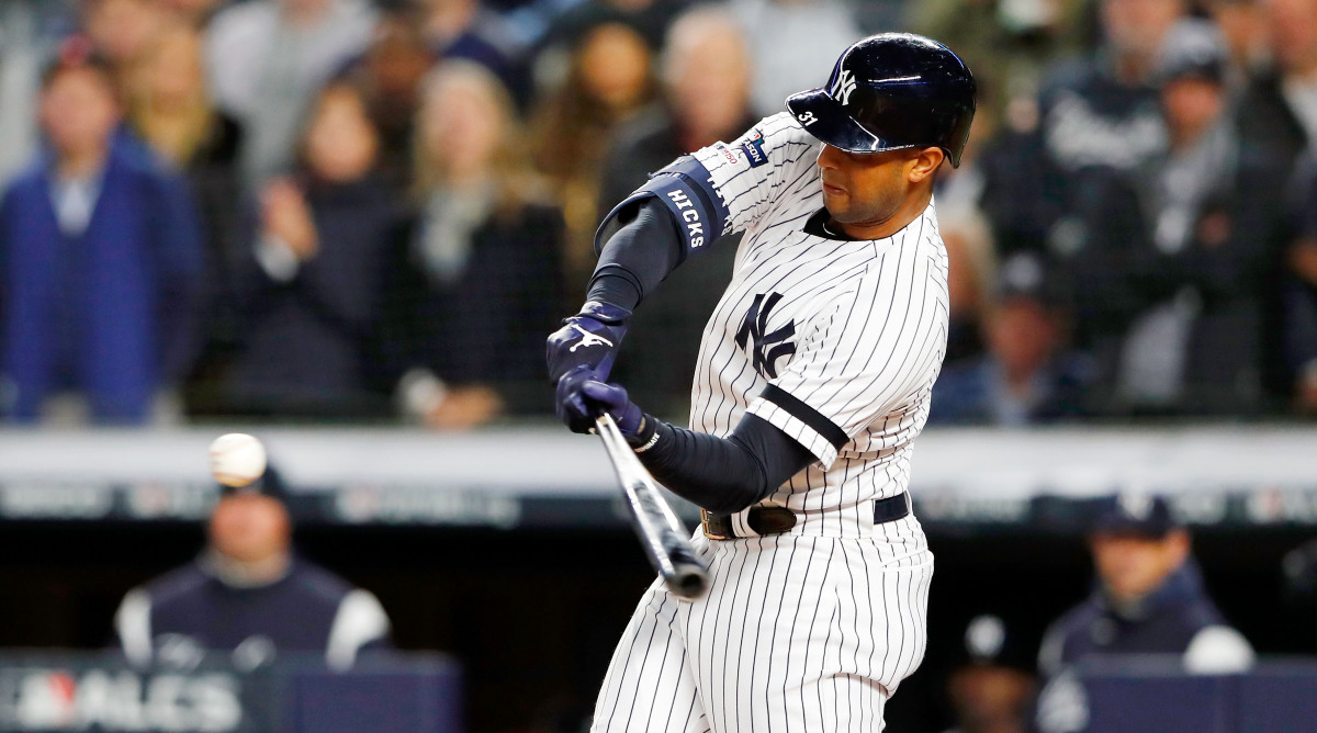 Oct 18, 2019; Bronx, NY, USA; New York Yankees center fielder Aaron Hicks (31) hits a three run home run against the Houston Astros during the first inning of game five of the 2019 ALCS playoff baseball series at Yankee Stadium. Mandatory Credit: Noah K. Murray-USA TODAY Sports