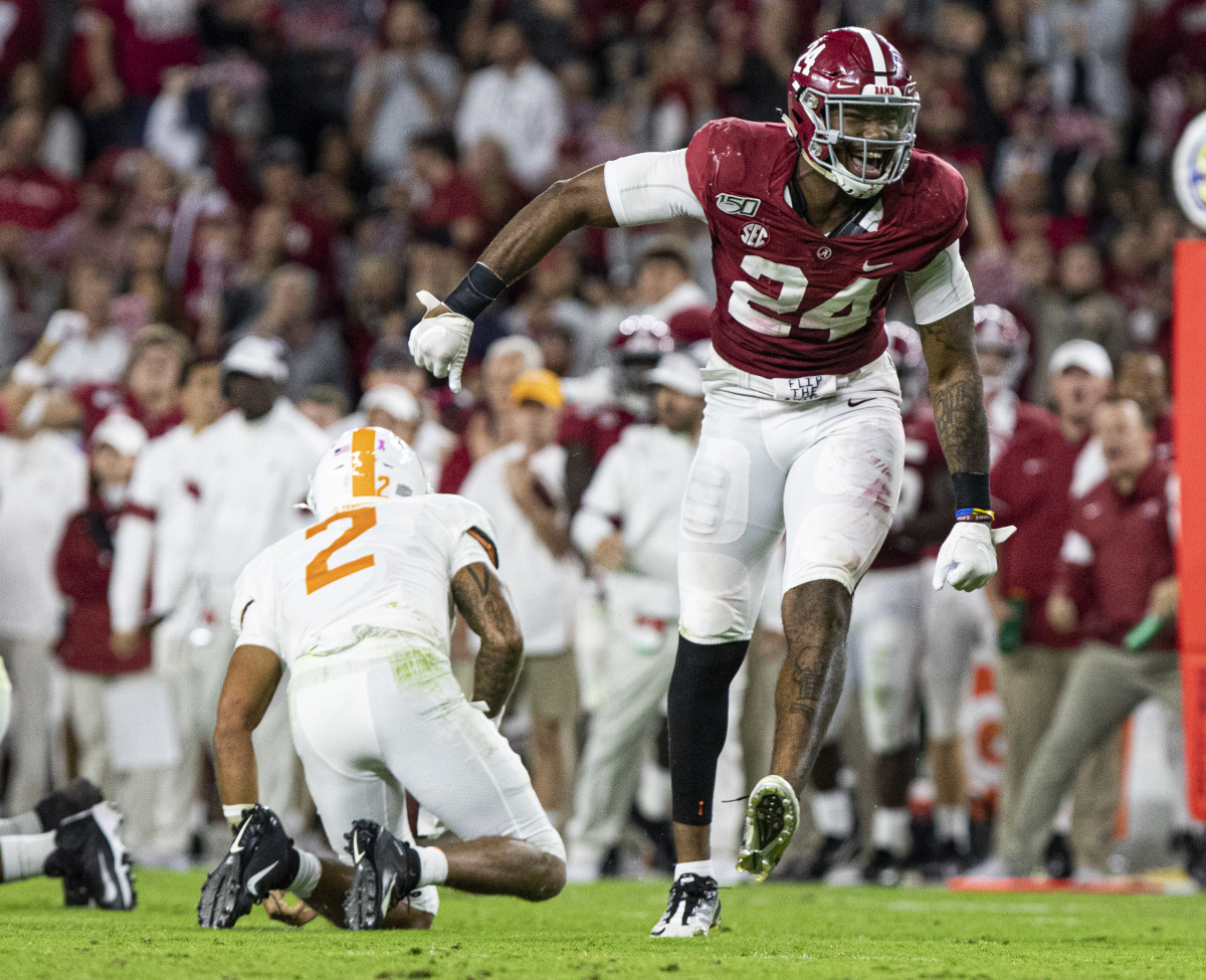 Terrell Lewis celebrates a sack against Tennessee