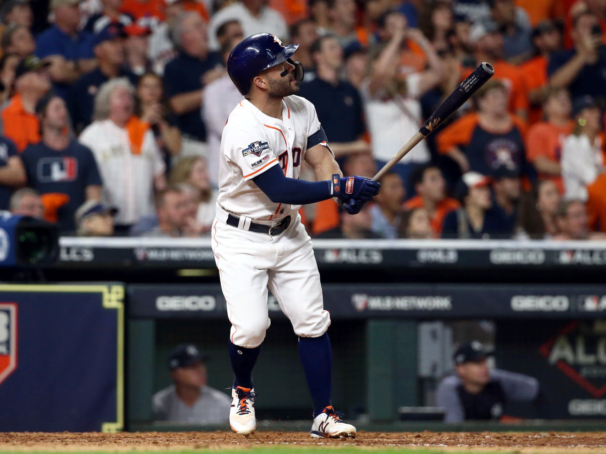 Oct 19, 2019; Houston, TX, USA; Houston Astros second baseman Jose Altuve (27) hits a 2-run walk off home run during the ninth inning against the New York Yankees in game six of the 2019 ALCS playoff baseball series at Minute Maid Park. Mandatory Credit: Troy Taormina-USA TODAY Sports