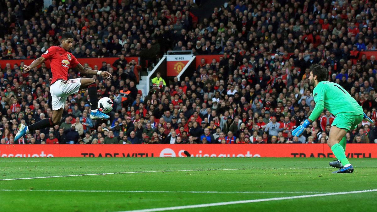Man United striker Marcus Rashford scores the opener past Liverpool goalkeeper Alisson at Old Trafford