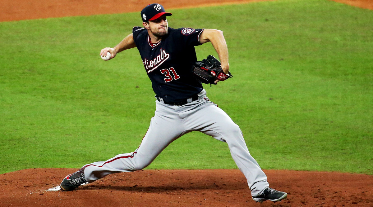 Oct 22, 2019; Houston, TX, USA; Washington Nationals starting pitcher Max Scherzer (31) throws against the Houston Astros during the first inning of game one of the 2019 World Series at Minute Maid Park. Mandatory Credit: Troy Taormina-USA TODAY Sports