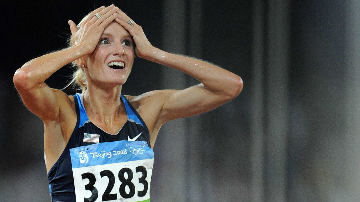 Shalane Flanagan looks at the results after earning a bronze medal in the 10,000 meters at the 2008 Olympics in Beijing. She would later be upgraded to silver due to a doping offense.
