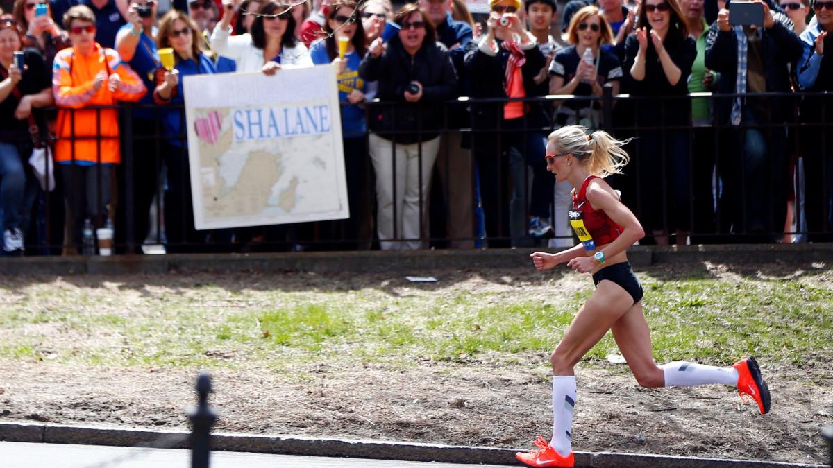 Shalane Flanagan charges through the Back Bay neighborhood during the 2014 Boston Marathon – just one year after the fatal twin bombings.