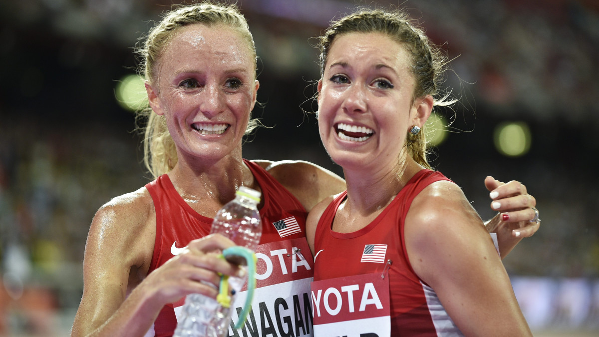 Shalane Flanagan celebrates her teammate Emily Infeld winning a bronze medal in the 10,000 meters at the 2015 IAAF World Championships in Beijing.