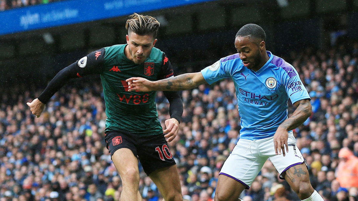 Jack Grealish contests with Raheem Sterling during Man City's victory over Aston Villa.