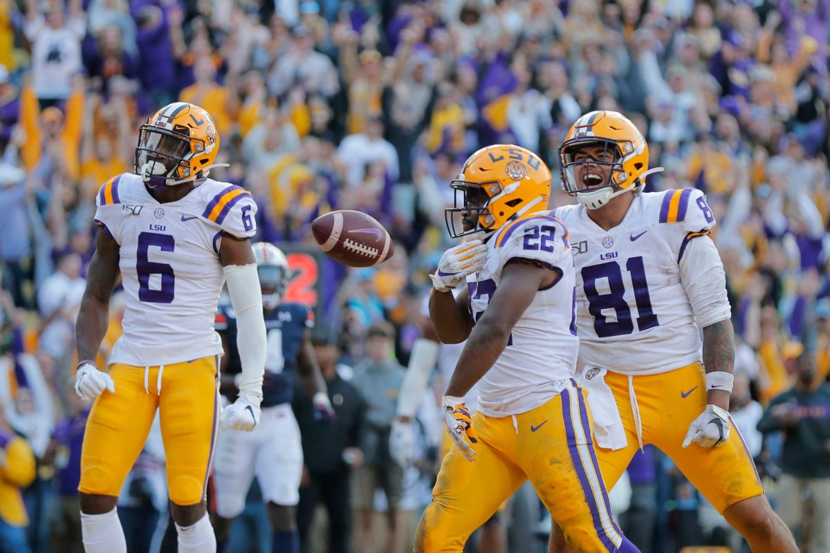 LSU running back Clyde Edwards-Helaire (22) celebrates his touchdown with tight end Thaddeus Moss (81) and wide receiver Terrace Marshall Jr. (6) in the second half of an NCAA college football game against Auburn in Baton Rouge, La., . LSU won 23-20