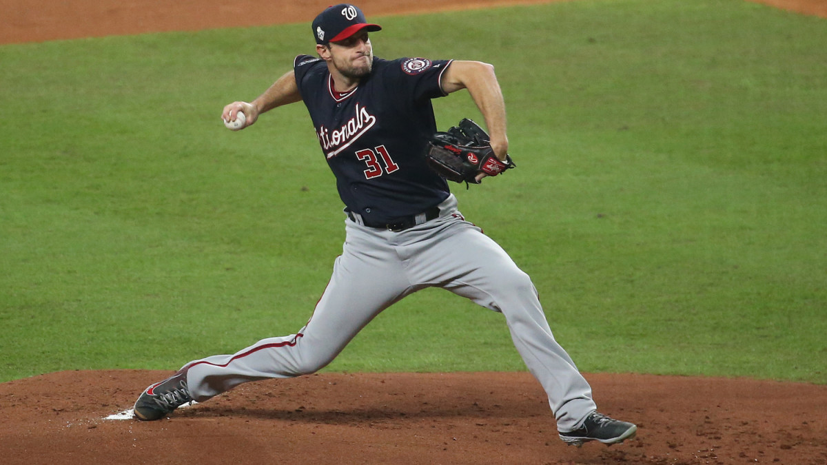 Mac Scherzer throws a pitch during Game 1 of the World Series between the Astros and Nationals.