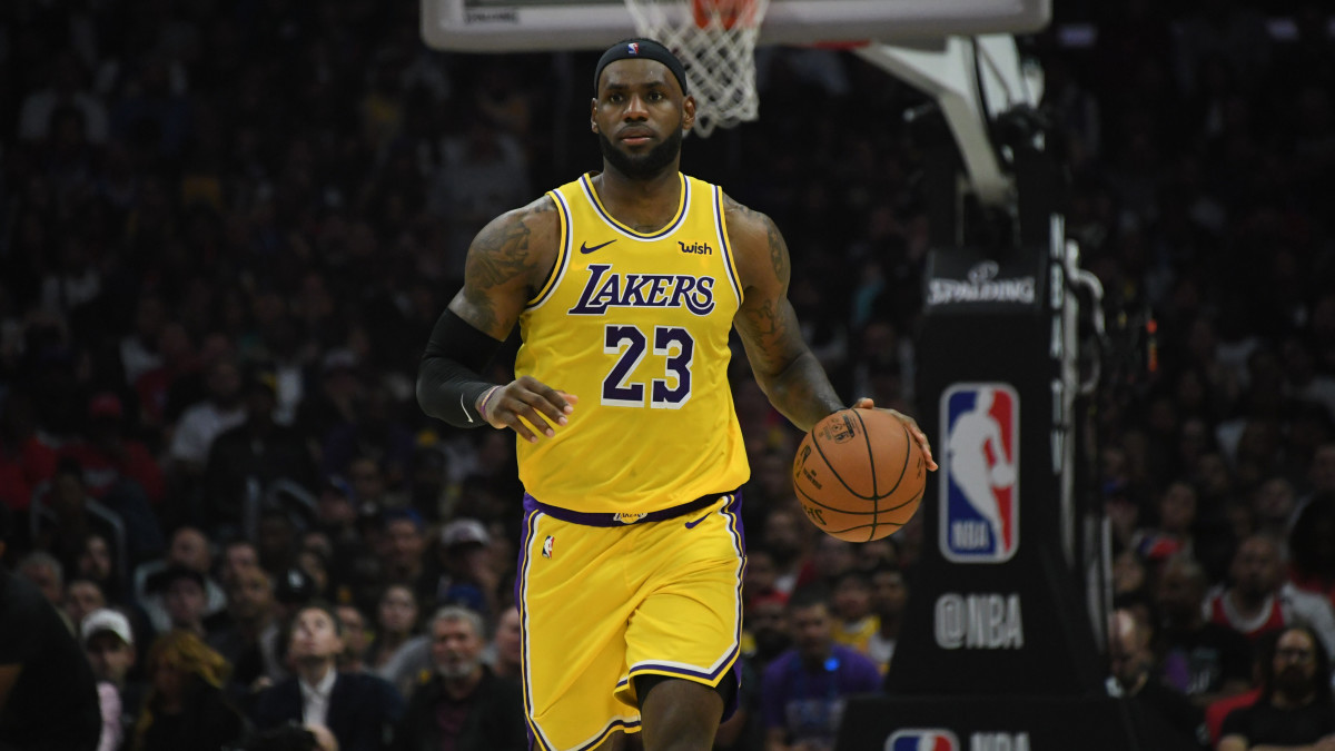Lakers' LeBron James dribbles the ball up the court