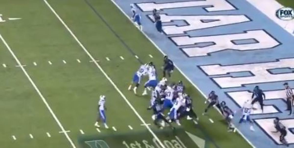 """Lower right (by the Es in """"Heels"""" in the end zone) four UNC defenders have Gray completely boxed in."""