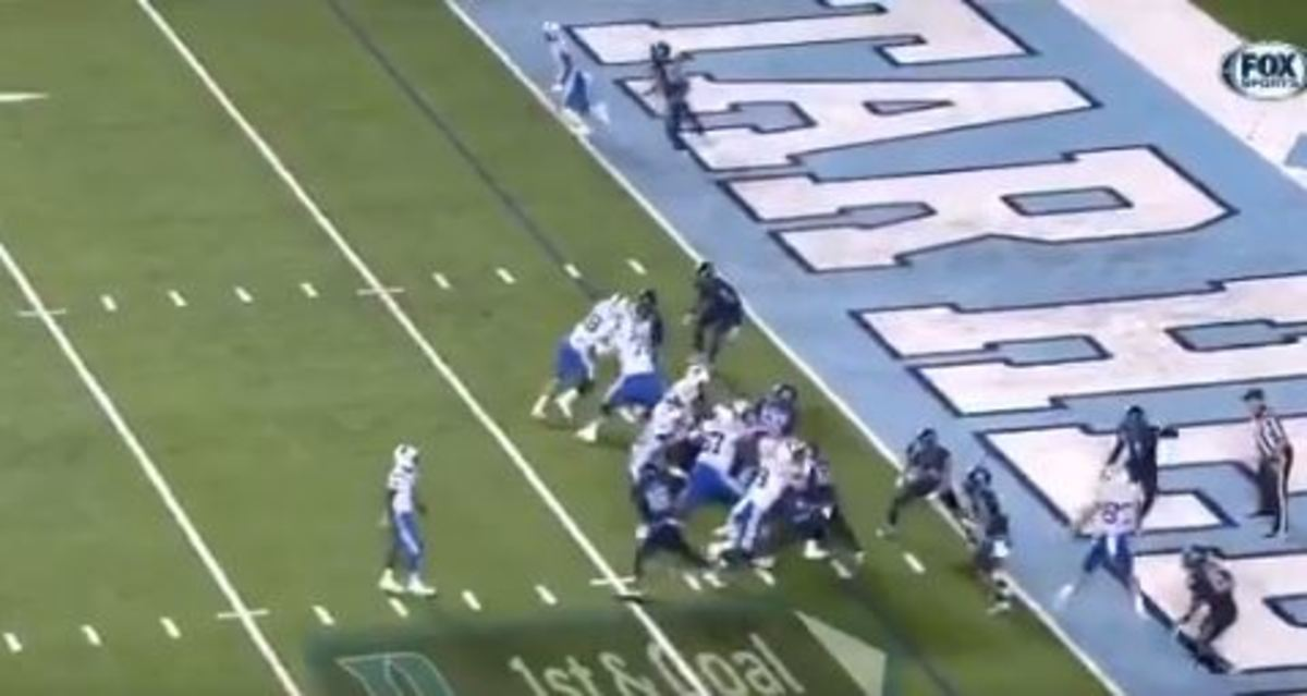 """Harris (above the Duke D) stands, hands down, inside the 8, watching the play. No defensive ends are paying him any attention. Ford (above the o in """"Goal"""" is already bearing down on Jackson."""