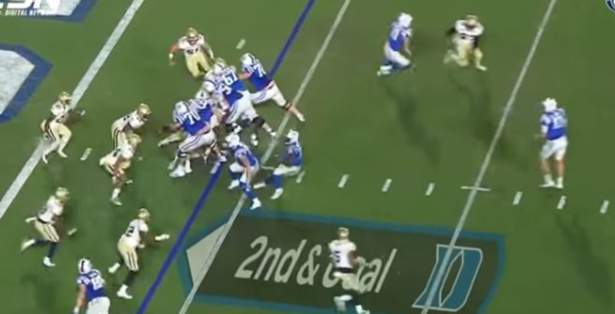 """Jones (far right) at the 12, as Wilson (at the six, just above the 2 in """"2nd & Goal"""") pulls up. Two GT edge rushers are at the nine yard line, pursuing Jones."""