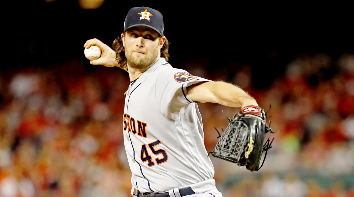 Oct 27, 2019; Washington, DC, USA; Houston Astros starting pitcher Gerrit Cole (45) pitches during the first inning against the Washington Nationals in game five of the 2019 World Series at Nationals Park. Mandatory Credit: Geoff Burke-USA TODAY Sports