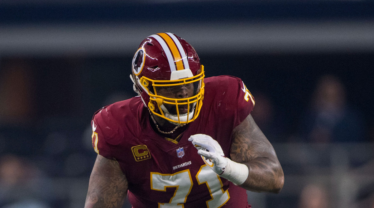trent-williams-ends-holdout-redskins