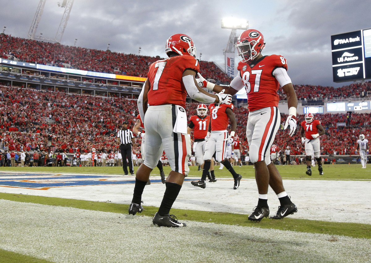 D'Andre Swift & Tyler Simmons celebrate a score in last year's game.