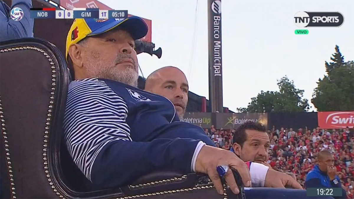 Diego Maradona coaches from a throne