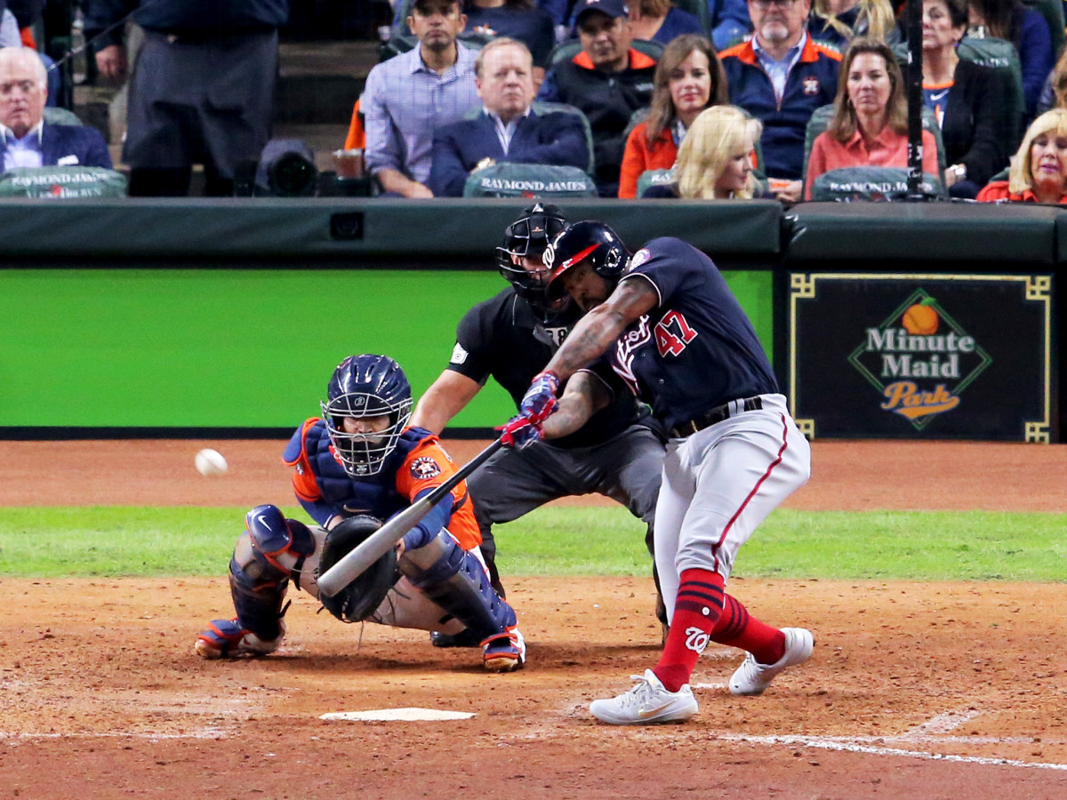 Oct 30, 2019; Houston, TX, USA; Washington Nationals designated hitter Howie Kendrick (47) hits a two-run home run against the Houston Astros during the seventh inning in game seven of the 2019 World Series at Minute Maid Park. Mandatory Credit: Erik Williams-USA TODAY Sports