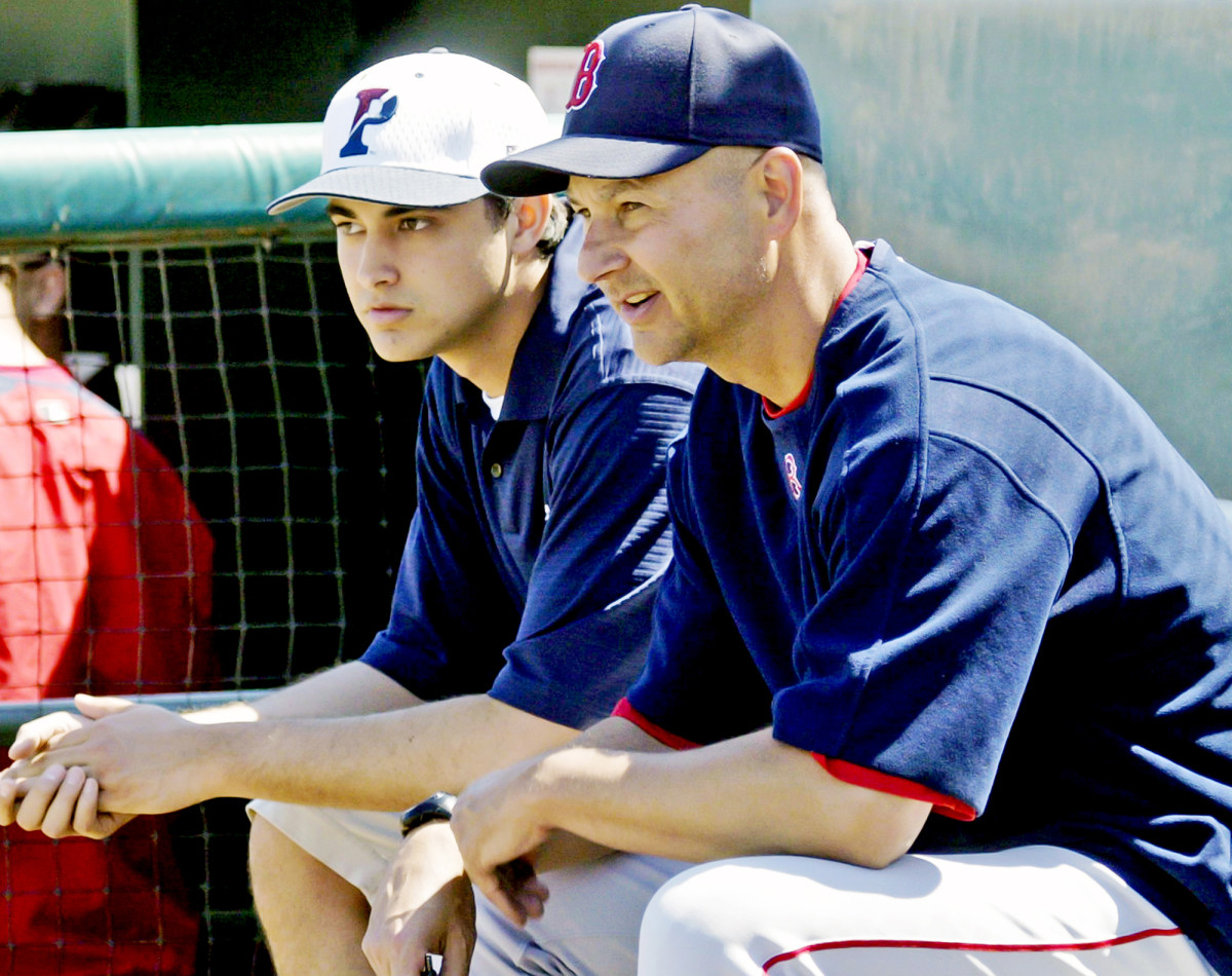 Terry Francona, right, sits with his son, Nick, before a Boston Red Sox spring training game in 2007.
