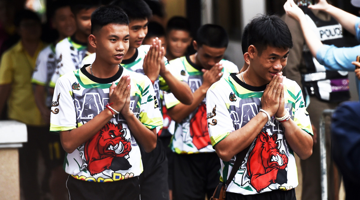 A year after Thai cave rescue, a fight over the story