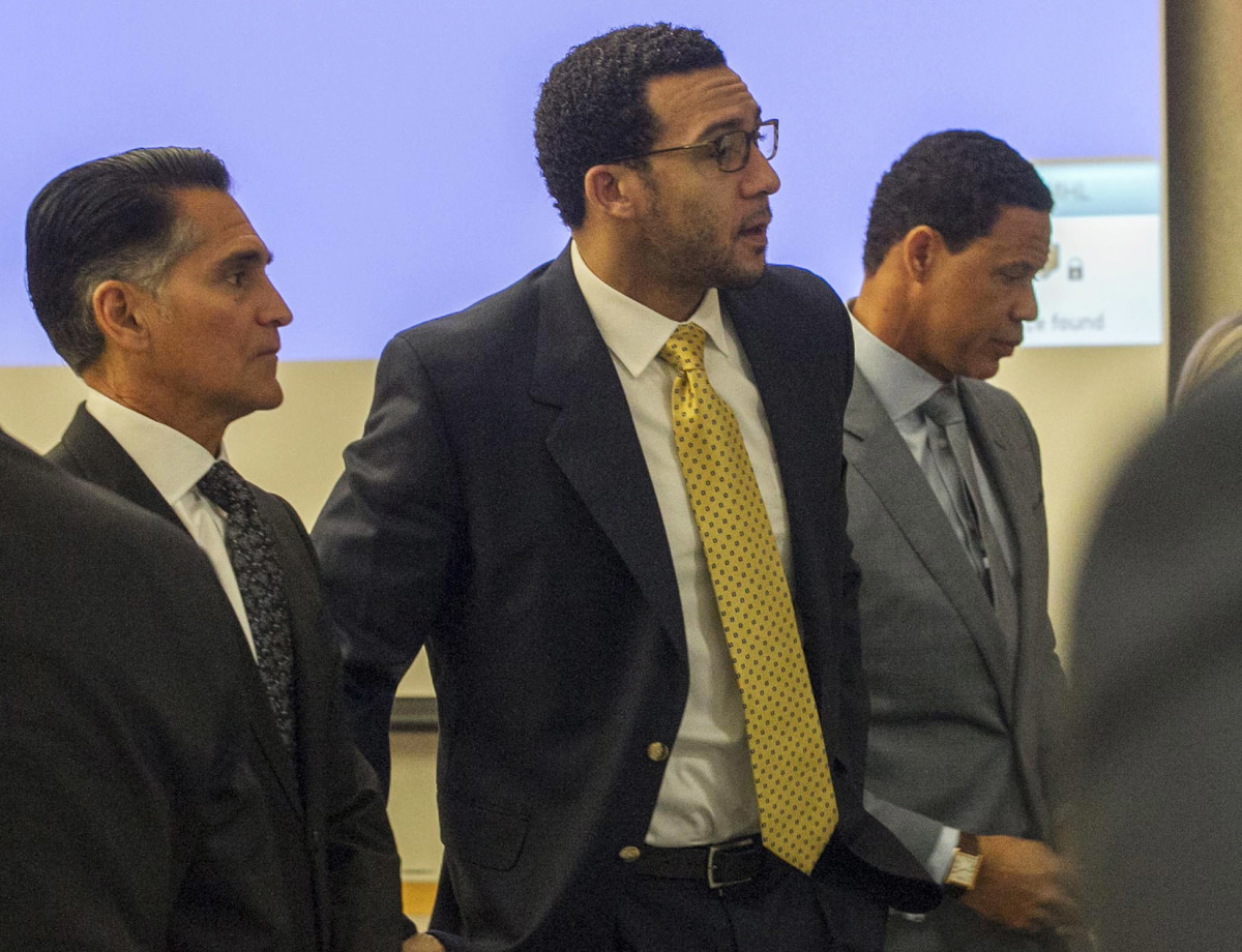 Winslow (center), flanked by trial attorneys Marc Carlos (left) and Brian Watkins (right).