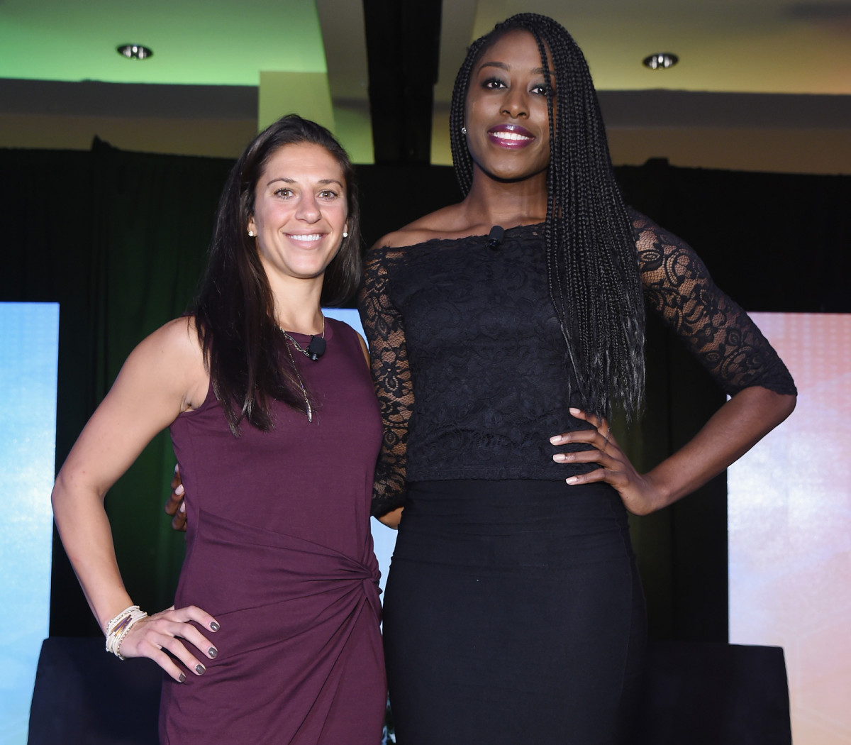 U.S. women's national team star Carli Lloyd stands with WNBA standout and players' association VP Chiney Ogwumike.