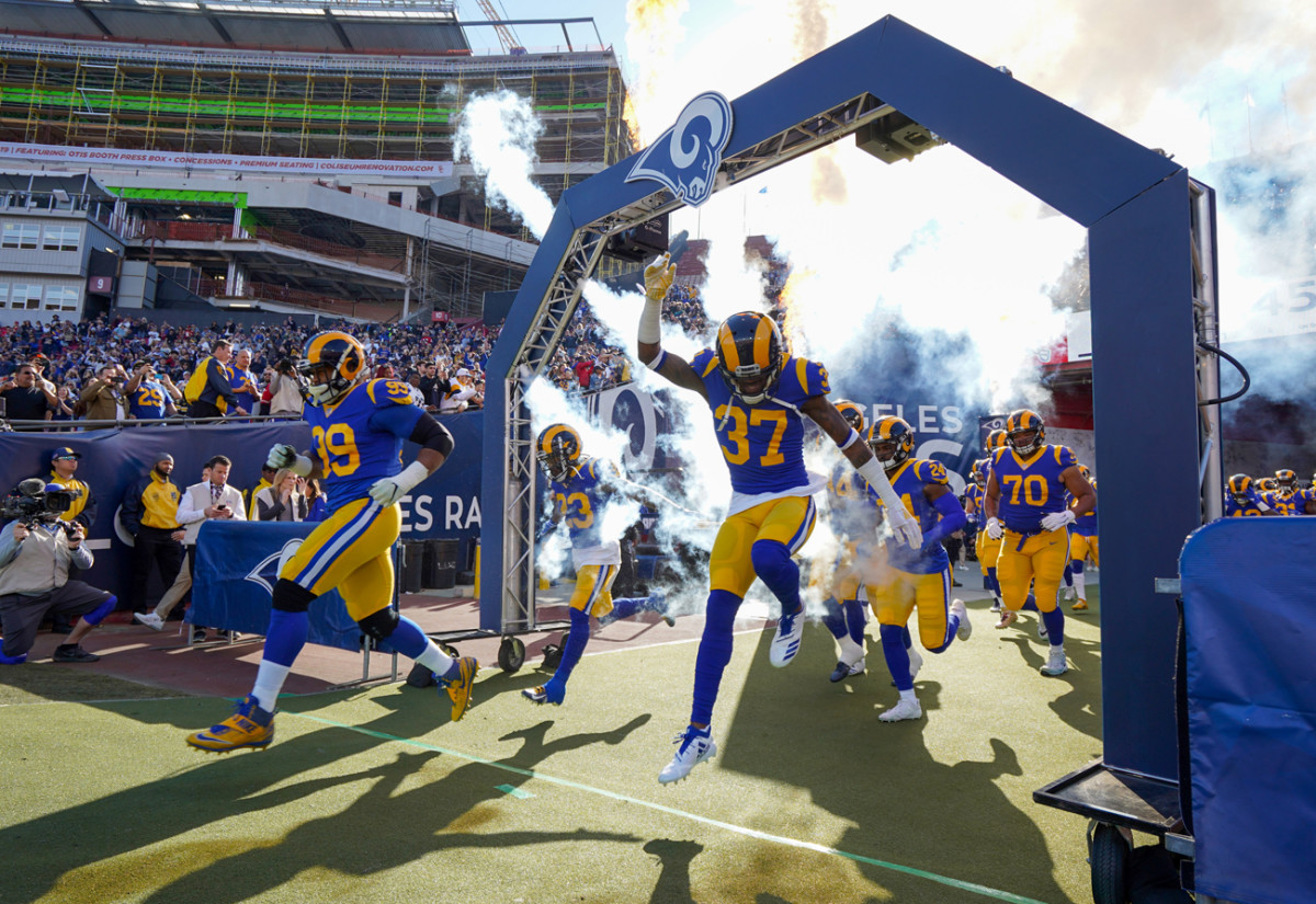 Entering the field with Aaron Donald for the season finale.