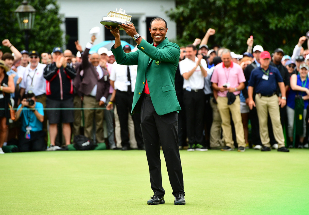 Tiger Woods celebrates his fifth Masters win