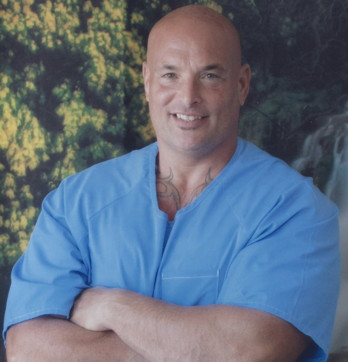 Naposki poses for a photo in his prison uniform in 2017.