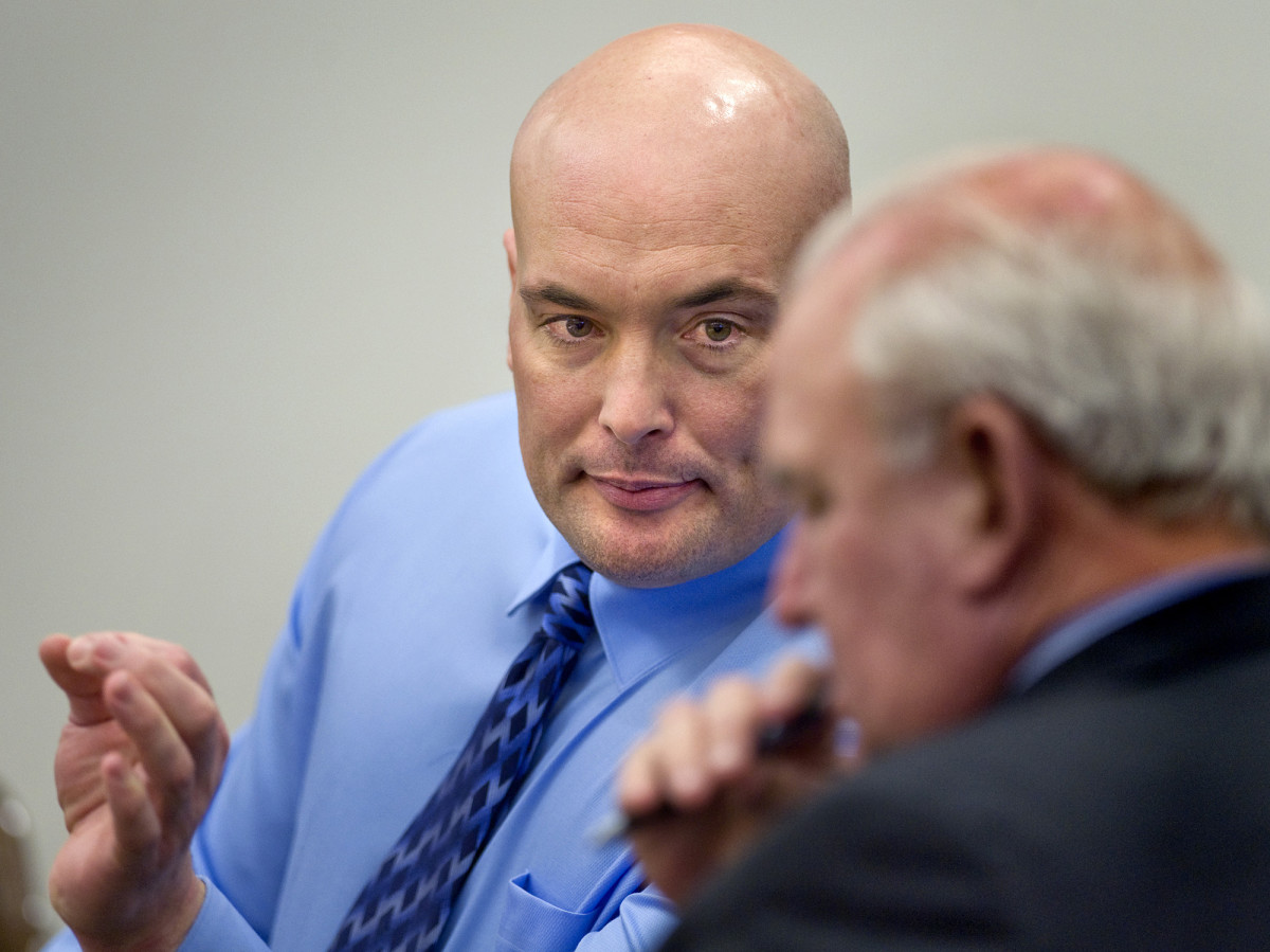 Naposki talks with one of his two attorneys, Gary Pohlson, during in his murder trial in 2011.