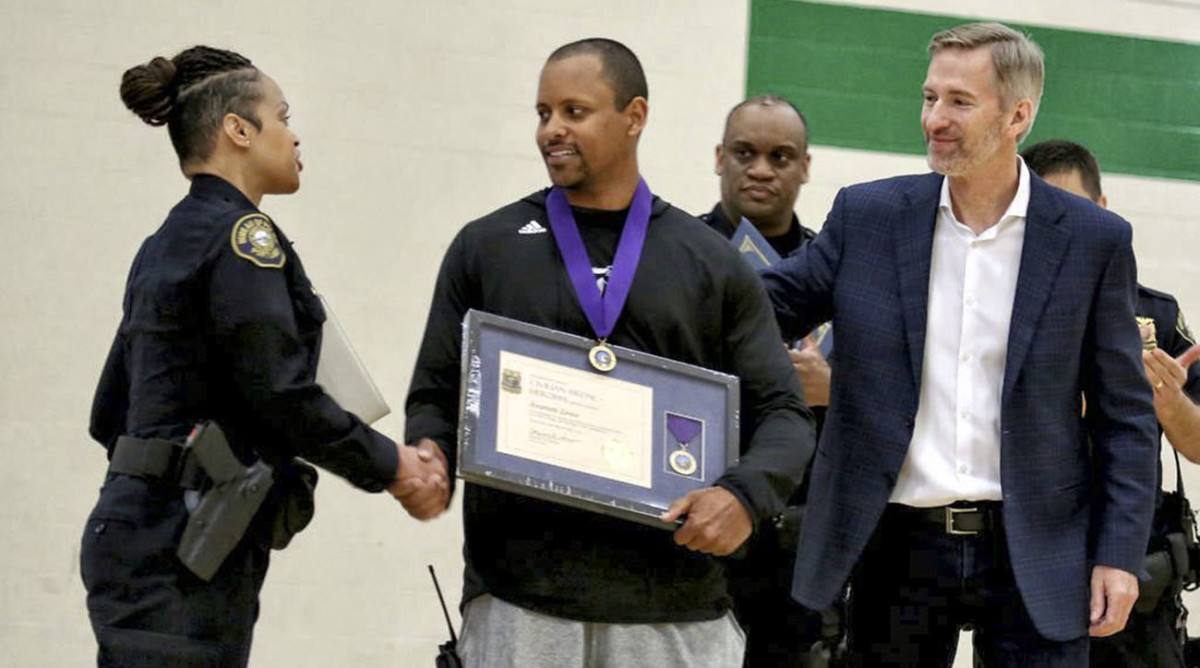 Among those who honored Lowe: the Portland PD, who handed him a Civilian Medal of Heroism.