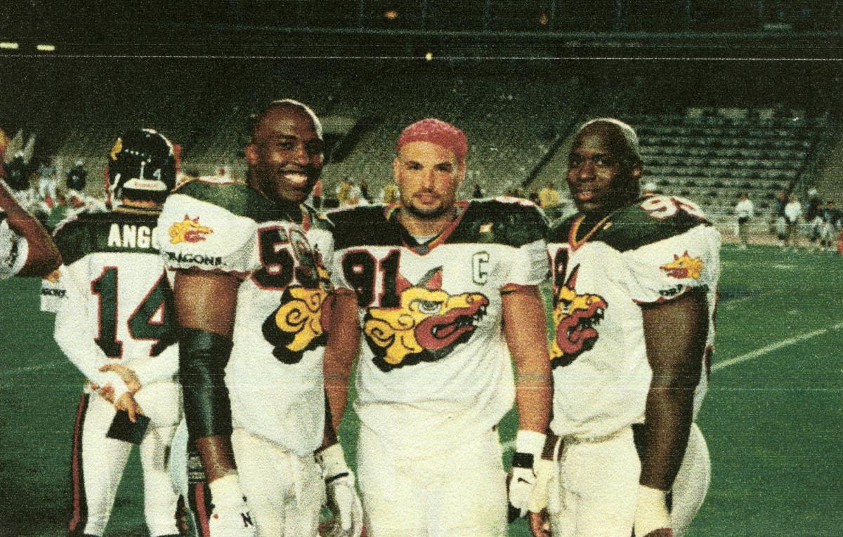 Naposki (center) with Barcelona Dragons teammates Juan Long (59) and La'Roi Glover (99).