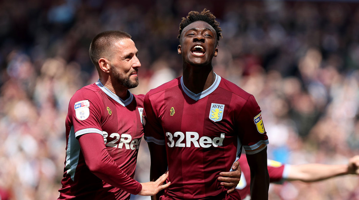 Tammy Abraham celebrates his penalty against West Brom with Conor Hourihane.