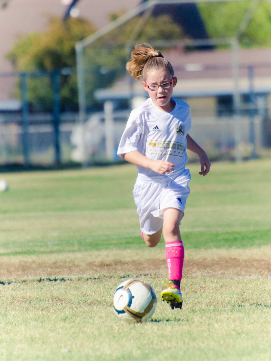 Olivia stood out at a young age, and by seven, she was playing two years up, trucking opponents with Golden State FC.