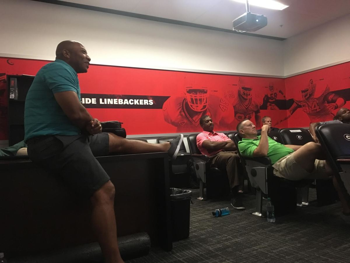 James Carter, far left, leads his officiating crew through a meeting from the Georgia outside linebackers position room. Carter's crew embedded for two days in UGA camp.