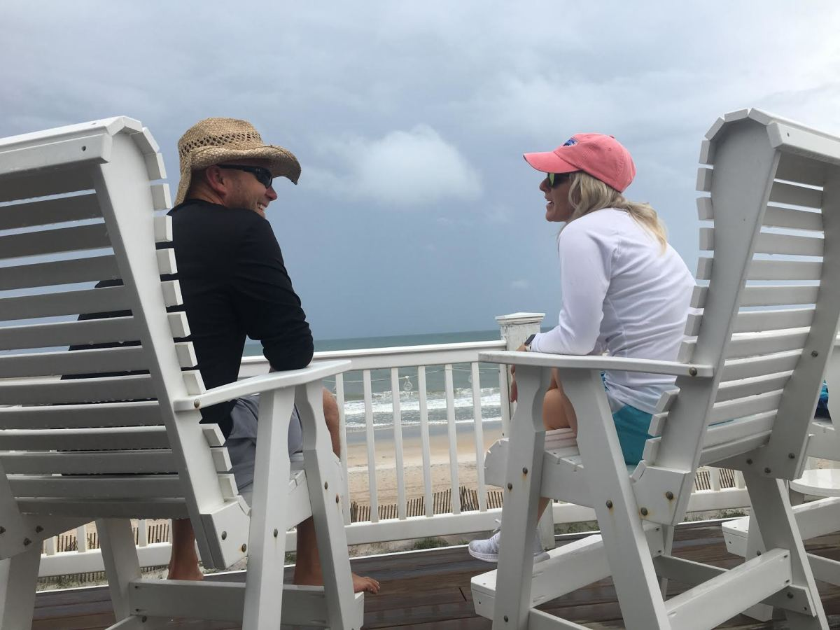 Matt Canada and wife Erin enjoy the sounds of crashing waves while on the porch of their beach house on Topsail Island, a barrier island off the coast of North Carolina.