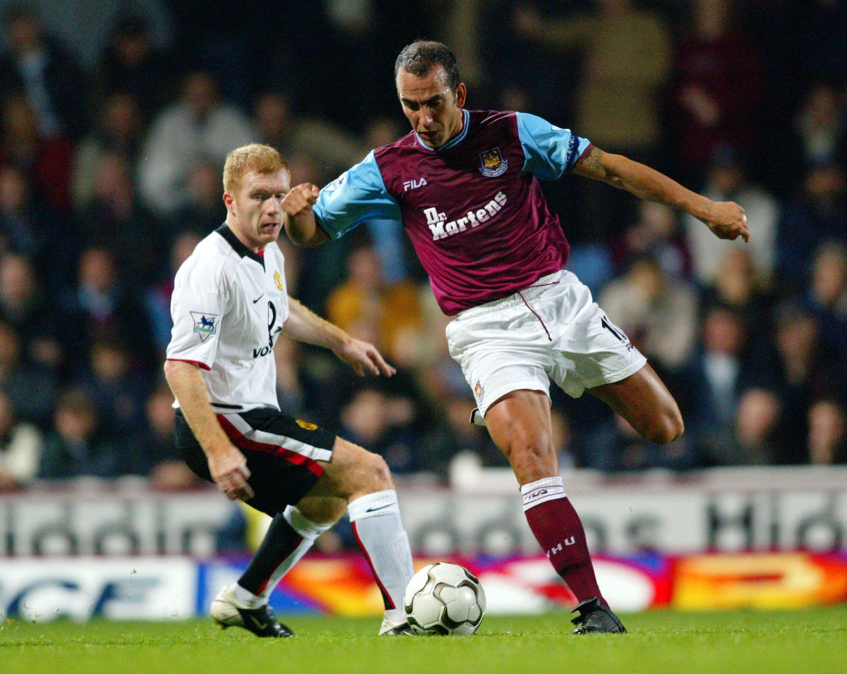 paolo-di-canio-of-west-ham-united-and-paul-scholes-of-manchester-united-5c83cb16a67cca9f79000001.jpg