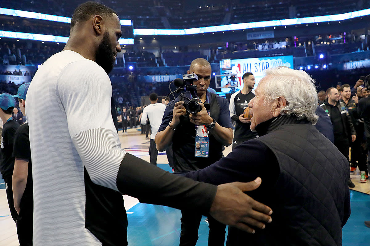 Robert Kraft (right) shakes hands with LeBron James at NBA All-Star Weekend.