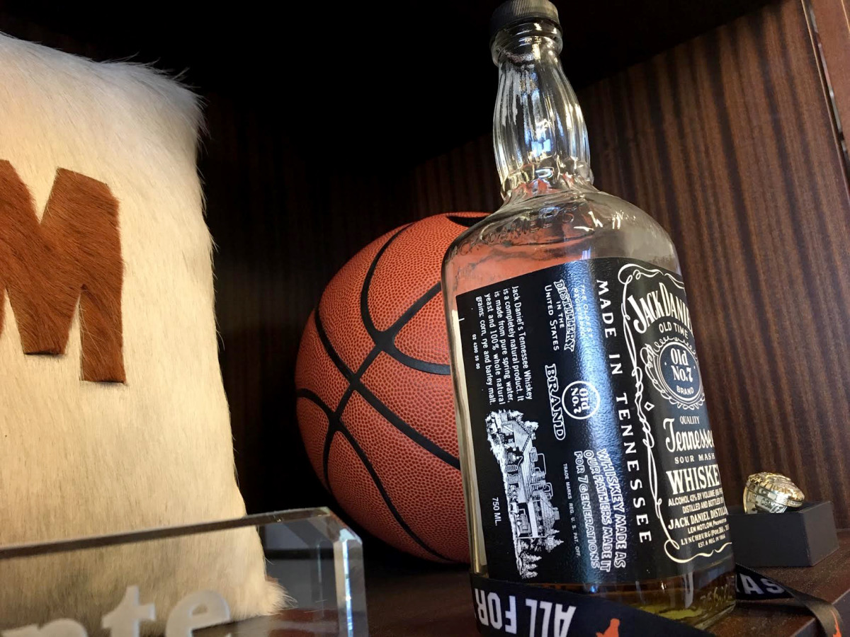 On a shelf in Texas athletic director Chris Del Conte's display cupboard is a mostly empty bottle of Jack Daniel's that belonged to Darrell Royal. Around these parts, it is a holy grail of sorts for the University of Texas.