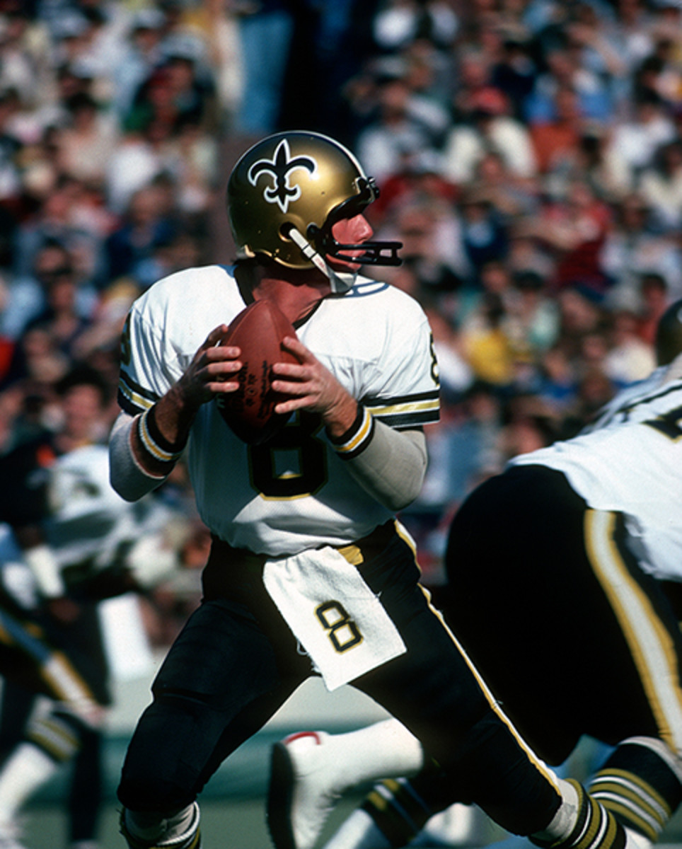 Saints quarterback Archie Manning wearing one of the many facemasks from his NFL career.
