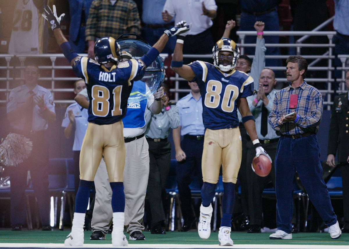 Isaac Bruce (No. 80) is perceived to be ahead of Holt in the Hall of Fame pecking order in large part due to his longevity (16 NFL seasons to Holt's 11). But in the nine seasons they played together, Holt had more receiving yards in eight of those years, and more catches in seven.