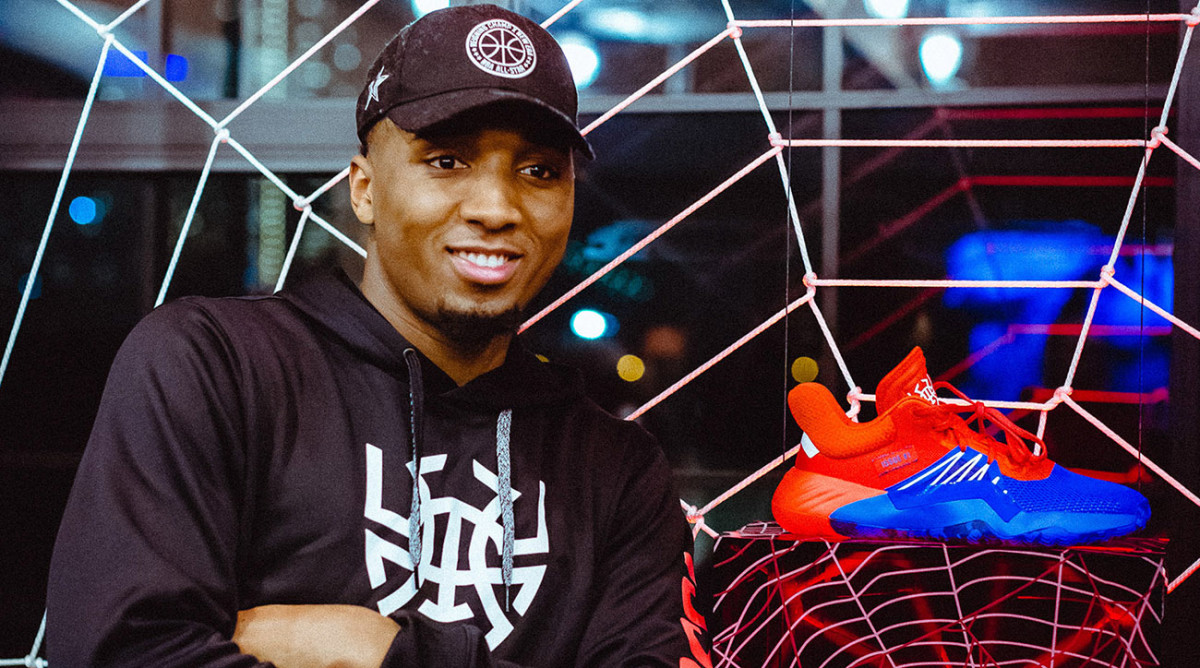 Donovan Mitchell shows off his D.O.N. Issue #1 with the Spider-Man color scheme.