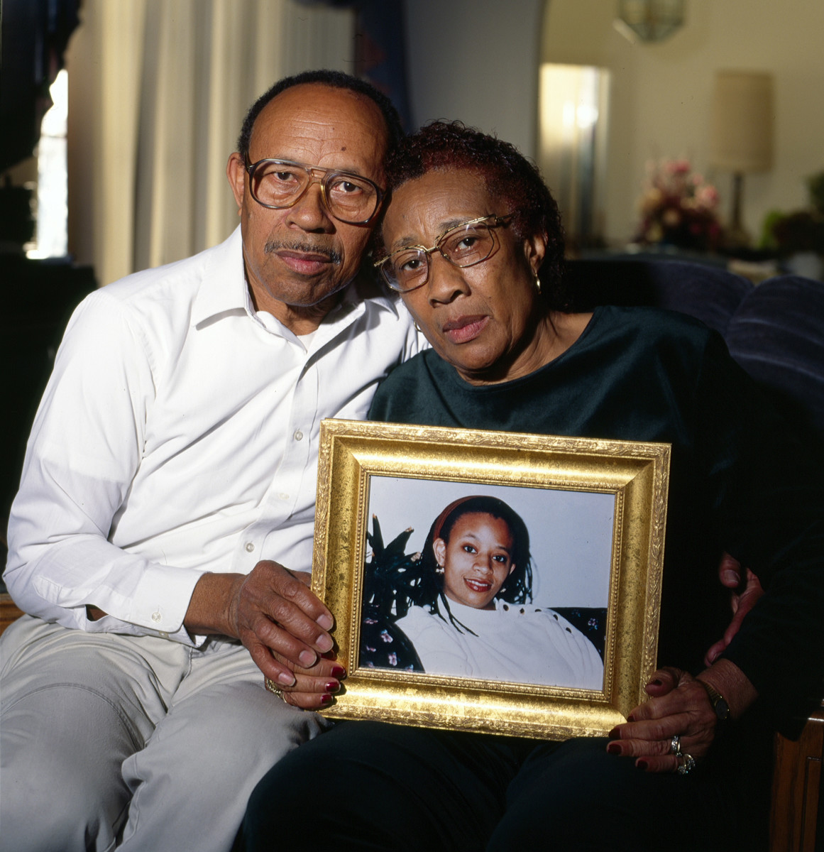 Alvin and Hazel Hayes hold a photo of their late daughter, Althea, in 1999. Hazel died in 2005.