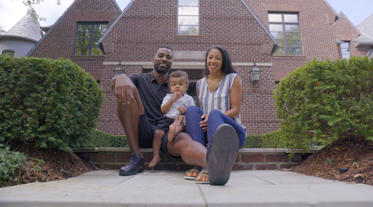 Calvin Johnson with his wife Brittney and son C.J.