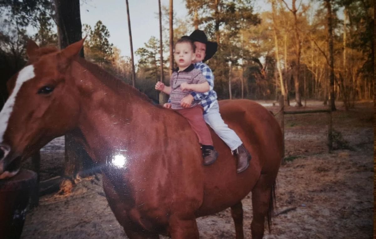 Jordan and Feleipe ride atop a horse on the family's land in rural Wakulla County, just south of Tallahassee, Florida.