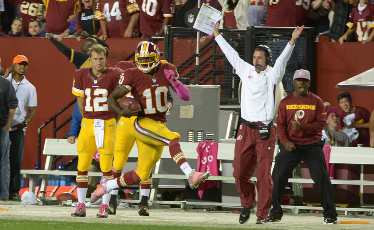 The good times rolled during RG3's rookie year, for the quarterback and the offensive cooridnator, Kyle Shanahan (in white).