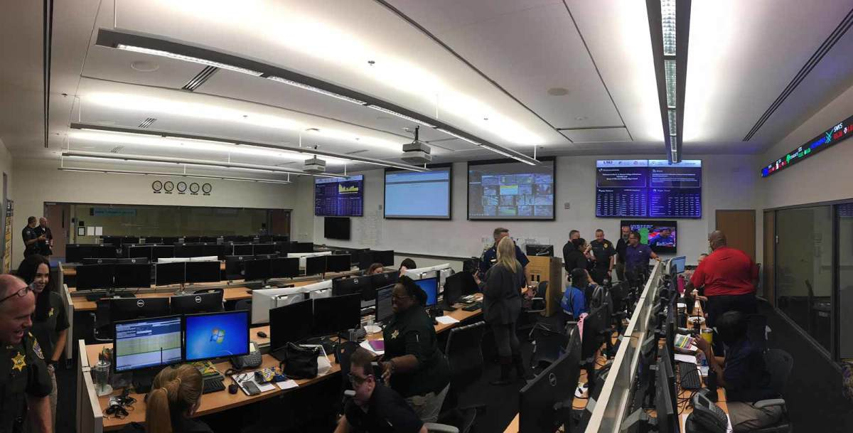 Officers and other officials gather in a computer lab at LSU's College of Business, which has been turned into a game day command center.