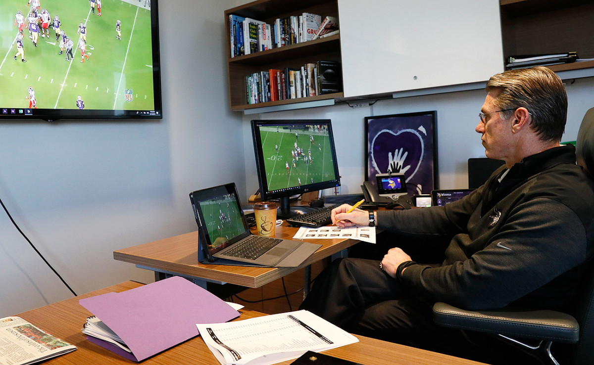 GM Rick Spielman cues up tape in his office.